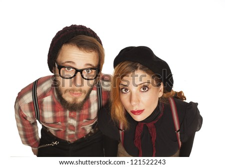 nerdy couple looking at camera isolated on white.closeup - stock photo