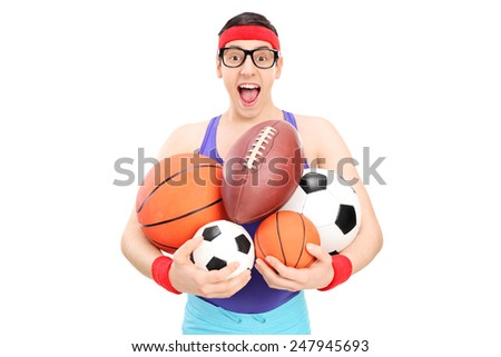 Nerdy guy holding a bunch of sports balls isolated on white background - stock photo