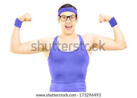 Nerdy guy in sportswear showing muscles isolated on white background - stock photo