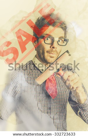 Nerdy male salesman washing red sale sign in store window. Advertising discounts - stock photo