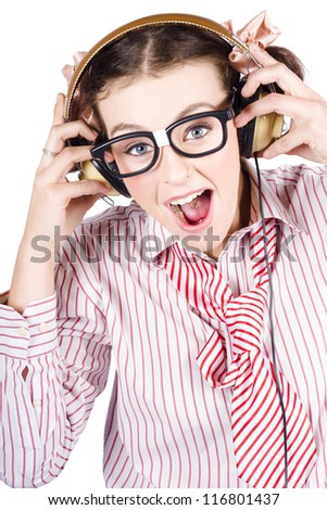 Nerdy Retro Schoolgirl In Pigtails Wearing Large Framed Glasses Raving To Music Yelling And Singing As She Listens To Her Set Of Headphones Isolated On White - stock photo