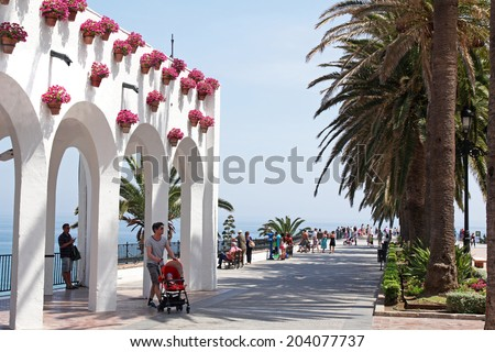 NERJA, MAY 10: Plaza Balcon de Europa; on May 10, 2014 Nerja, Spain. Nerja is famous resort on Costa del Sol situated 50 km from Malaga.  - stock photo