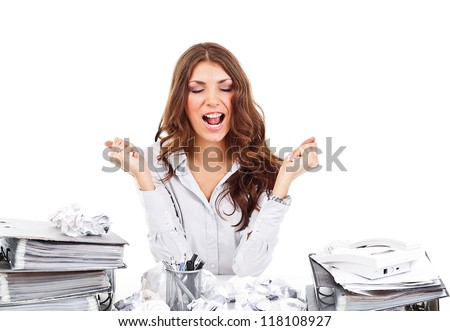 Nervous businesswoman at the office whit paperwork - stock photo