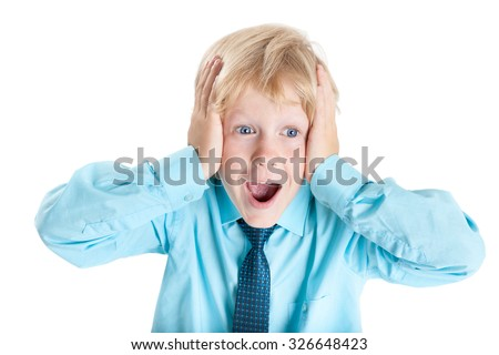 Nervous Caucasian blond schoolboy in blue shirt screams while holding his head with hands, isolated on white background - stock photo
