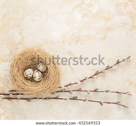 nest with quail eggs and willow twigs on the background of marble. top view. copy space - stock photo
