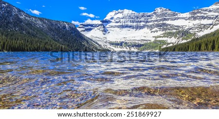 Nestled in a glacial basin, Cameron Lake is a hidden jewel high in the Canadian Rockies. Part of Waterton Lakes National Park,Cameron Lake offers fishing, hiking trails, boating and breathtaking views - stock photo
