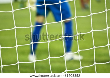 Net and soccer player - stock photo