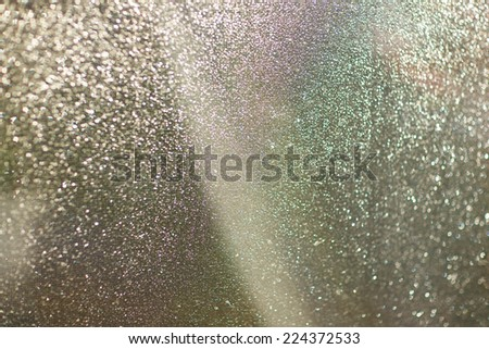 Net curtain covered with beautiful drops of water on a warm sunny day after the rain - stock photo