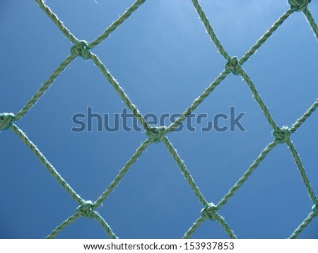 Net on sky background - stock photo