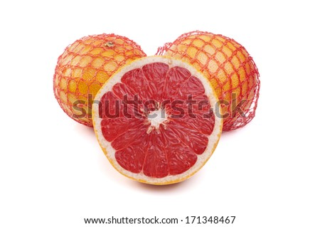 Net with fresh grapefruits on a white background - stock photo