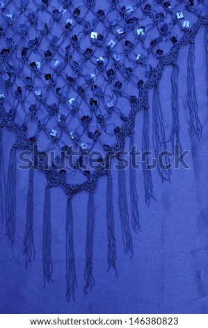 Net with Square Sequins above the cloth background - stock photo