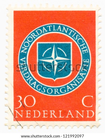 NETHERLANDS - CIRCA 1959: A stamp printed in Netherlands shows NATO Emblem, circa 1959 - stock photo