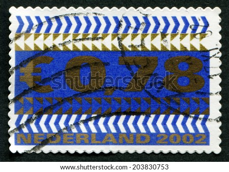 NETHERLANDS - CIRCA 2002: A stamp printed in the Netherlands, and the arrow shows the value of a postage stamp, circa 2002 - stock photo