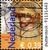 NETHERLANDS - CIRCA 2003: A stamp printed in the Netherlands, is dedicated to the 150th anniversary of Vincent Van Gogh, shows a self-portrait in a straw hat, circa 2003 - stock photo