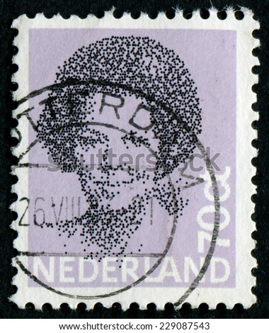 NETHERLANDS - CIRCA 1984: A stamp printed in the Netherlands shows image of Queen Beatrix, 1984 - stock photo
