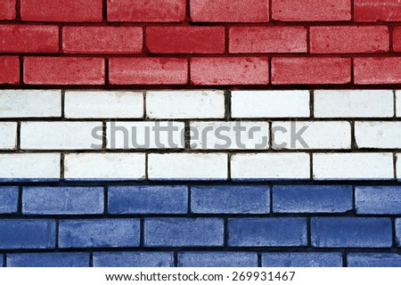 Netherlands flag painted on old brick wall texture background - stock photo