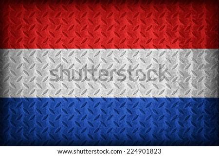 Netherlands flag pattern on the diamond metal plate texture ,vintage style - stock photo