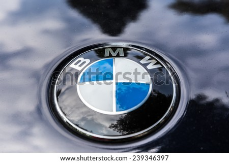 NETHERLANDS - SEPTEMBER 22, 2014: Parked BMW with recognisable round logo on September 22, 2014 in the Netherlands. The BMW logo evolved from the logo of aircraft engine manufacturer Rapp. - stock photo