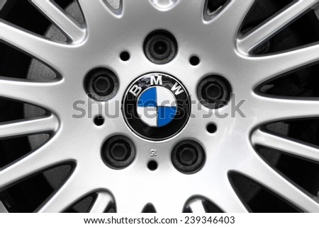 NETHERLANDS - SEPTEMBER 22, 2014: Parked BMW with the BMW logo and alloy wheel on September 22, 2014 in the Netherlands. Light alloy wheels emphasise the dynamic character and exclusive style of BMW. - stock photo