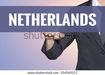 Netherlands word Business man touch on virtual screen soft sweet vintage background - stock photo