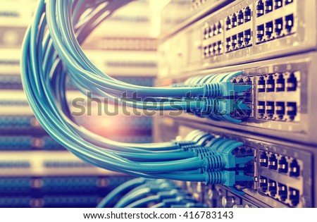 Network cable and switch,Data Center Concept. - stock photo