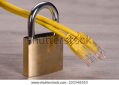 Network cable in padlock. Protected internet connection - stock photo