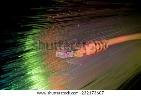network cable with high tech technology color background - stock photo