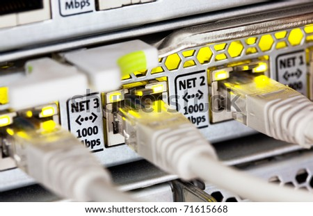 Network cables and hub. Closeup view with shallow DOF - stock photo
