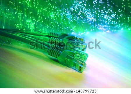 network cables closeup with fiber optical background - stock photo