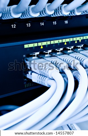 network cables connected to a switch and patch-panel - stock photo
