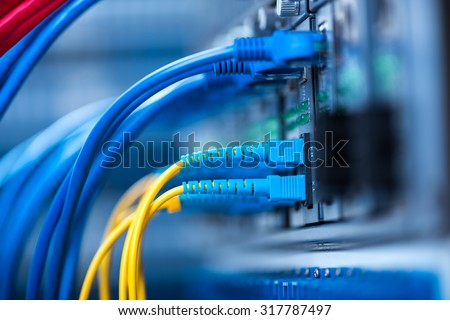 network cables installed in the rack - stock photo
