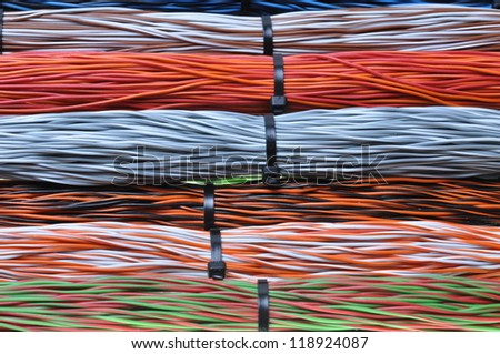 Network cables, wires in telecommunication and computer networks - stock photo
