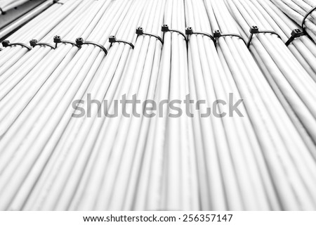 Network communication cables organised in bundles - stock photo