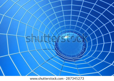 Network concept, clear drop of water in spider web on blue background - stock photo