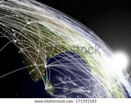 Network concept with sun rising over Indian subcontinent viewed from space. Highly detailed planet surface with clouds and city lights. Elements of this image furnished by NASA. - stock photo