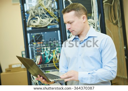 network engineer admin at data center - stock photo