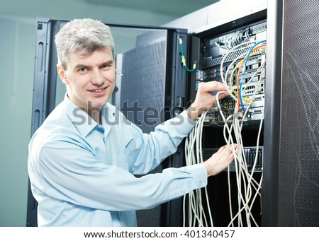 network engineer administrator in server room  - stock photo