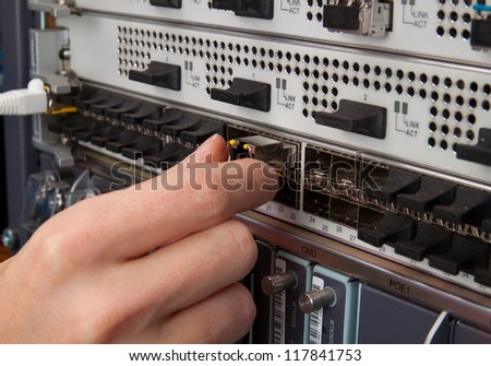 Network engineer insert transceiver - stock photo