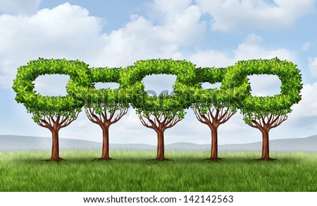 Network growth business concept as a group of growing green trees in the shape of a linked chain connected together as an icon of financial cooperation for wealth building and environmental teamwork. - stock photo