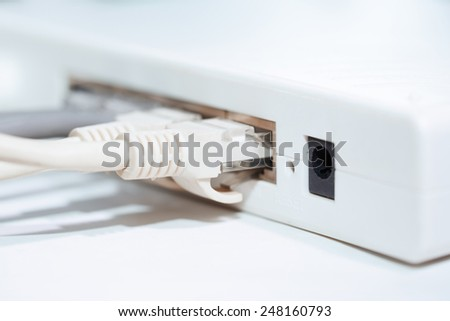 Network modem with cables. Close-up horizontal photo - stock photo