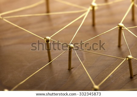 Network, networking, internet communication abstract. Web of gold wires on rustic wood. - stock photo