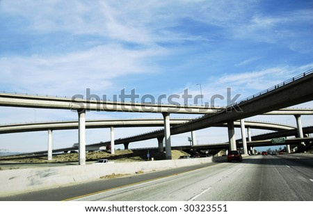 network of freeway roads with overpass and underpass in america - stock photo