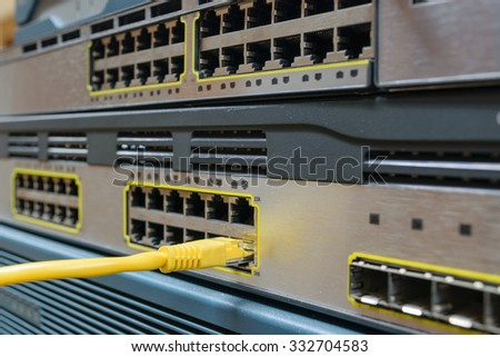 Network switch HUB and ethernet cables (LAN)  in datacenter - stock photo