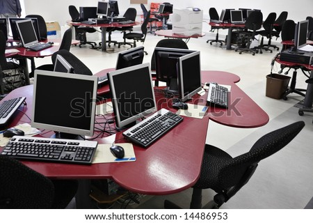 Networked desktop computers in a college modern laboratory. - stock photo