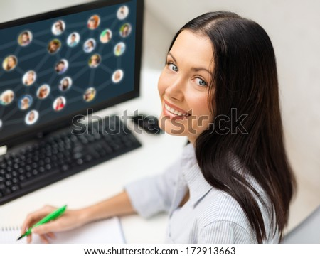networking, business and technology concept - smiling businesswoman studying with computer - stock photo