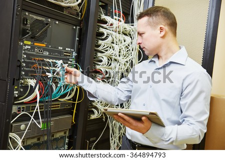 Networking service. network engineer administrator checking server hardware equipment of data center - stock photo
