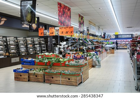 NEUENHAUS, GERMANY - MAY 21: The fresh department of a Lidl supermarket. Lidl is a German discount chain, 9800 stores, in 28 countries in Europe. Photo taken on May 21, 2015 in Neuenhaus, Germany - stock photo