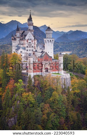 Neuschwanstein Castle. Image of the Neuschwanstein Castle surrounded with autumn colors during sunset. - stock photo
