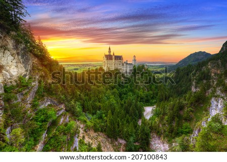Neuschwanstein Castle in the Bavarian Alps at sunset, Germany - stock photo