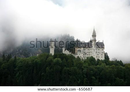 Neuschwanstein castle in the mist - stock photo